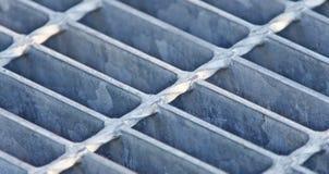 Foto av härliga celler för ett grå färgmetallgolv Royaltyfri Foto