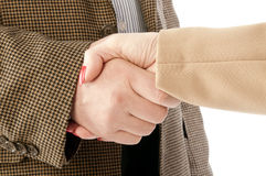 Foto av handskakningen av affärspartners, når att ha slågit avtal Arkivfoton