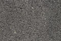Foto av mörker asfalterad yttersidabakgrund Royaltyfri Bild