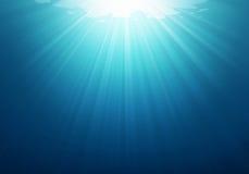 Foto azul subaquática do fundo do mar ilustração stock