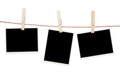 Foto in bianco che appendono sulla corda da bucato Fotografie Stock