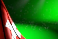 Foto bonita da bandeira de Suíça que pendura no canto no verde com foco seletivo e no espaço livre para o texto - alguma bandeira ilustração royalty free