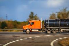 Foto borrada do caminhão no movimento Fotografia de Stock Royalty Free
