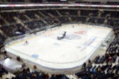 Foto borrosa de la arena apretada del hockey Imagen de archivo