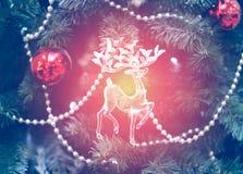 Foto brillante con el reno del juguete Imagen de archivo libre de regalías