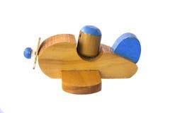 Foto común: Aeroplano de madera del juguete aislado en blanco Fotografía de archivo