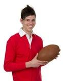 Foto conservada em estoque de um homem com uma bola de rugby Imagens de Stock Royalty Free