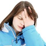Foto conservada em estoque de uma menina de encontro à parede azul Fotografia de Stock Royalty Free