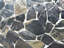 Foto conservada em estoque do fundo de superfície da parede de pedra da rocha fotos de stock