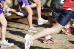 Foto conservada em estoque dos corredores de uma equipe do país transversal Fotografia de Stock Royalty Free