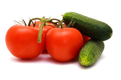 Foto of cucumbers  and tomatoes in room Royalty Free Stock Photos