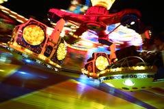 Foto da ação de montar um merrygoround Imagens de Stock Royalty Free