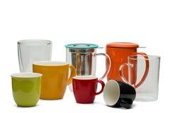 Foto da categoria com as canecas, os copos e os vidros do serviço do chá fotos de stock royalty free