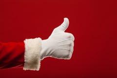 Foto da mão gloved de Santa Claus em apontar foto de stock royalty free