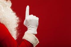 Foto da mão gloved de Santa Claus em apontar imagens de stock royalty free