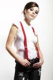 Foto da menina bonita que estica suspenders imagem de stock royalty free
