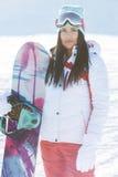 Foto da mulher com snowboard fotografia de stock royalty free