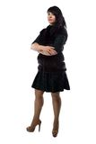 Foto da mulher rechonchudo no revestimento da pele, braços cruzados Fotografia de Stock Royalty Free