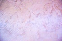 Foto da textura áspera cor-de-rosa da parede do estuque imagens de stock royalty free