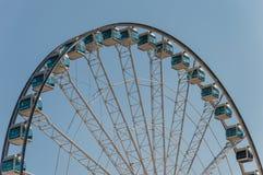 Foto de la acción de Ferris Wheel Fotografía de archivo libre de regalías