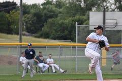 Foto de la acción del juego de béisbol foto de archivo