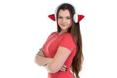 Foto de la muchacha en auriculares de Navidad con los brazos cruzados Imagen de archivo