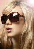 Foto de la muchacha en gafas de sol Fotografía de archivo