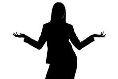 Foto de la silueta de la mujer con las manos abiertas Fotografía de archivo libre de regalías