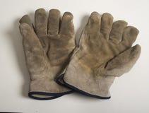 Foto de los guantes viejos del trabajo Fotografía de archivo