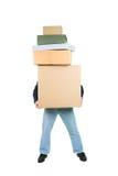 Foto de um homem que prende muitas caixas em suas mãos Imagens de Stock Royalty Free