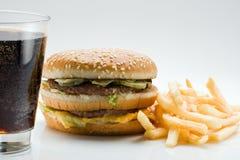 Patatas fritas y cola de la hamburguesa Imágenes de archivo libres de regalías