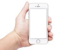 Foto de una mano usando el iphone 5s Imagen de archivo libre de regalías
