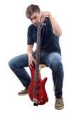 Foto del adolescente con la guitarra baja Foto de archivo libre de regalías