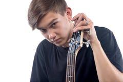 Foto del adolescente con la guitarra baja Fotografía de archivo libre de regalías