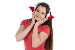 Foto del adolescente con los auriculares de Navidad Imagenes de archivo