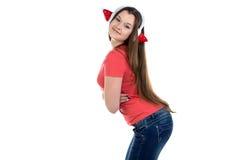 Foto del adolescente lindo en auriculares de Navidad Fotografía de archivo