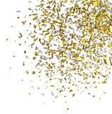 Foto del confeti de oro en un fondo blanco Foto de archivo libre de regalías