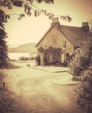 Foto del estilo del vintage de la cabaña rural por el mar Imágenes de archivo libres de regalías