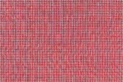 Foto del fondo de la tela con el modelo rojo comprobado de la guinga Fotografía de archivo