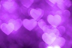 Foto del fondo del bokeh del corazón púrpura, contexto abstracto del día de fiesta Imagen de archivo libre de regalías