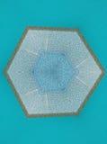 Foto del kaleidoskope di Abstact delle mattonelle su fondo blu Fotografia Stock Libera da Diritti