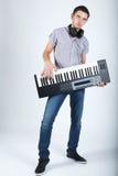 Foto del muchacho con el piano Fotos de archivo libres de regalías