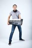 Foto del muchacho con el piano fotografía de archivo