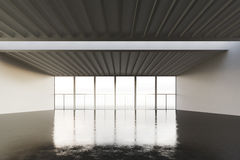 Foto del posto dello spazio aperto in costruzione moderna Stile interno vuoto del sottotetto con il pavimento di calcestruzzo e l Fotografia Stock