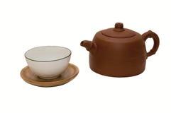 Foto del primer de la tetera marrón con la taza de té Fotografía de archivo libre de regalías