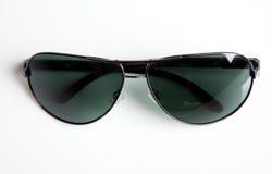 Foto del primo piano degli occhiali da sole Fotografia Stock
