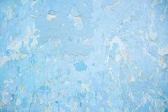 Foto del primo piano della struttura approssimativa blu della parete dello stucco fotografia stock