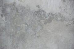 Foto del primo piano della struttura grigia della parete dello stucco immagine stock