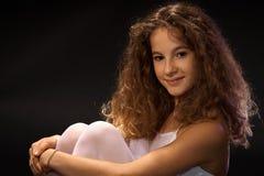 Foto del primo piano di giovane ragazza sorridente Immagine Stock
