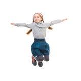 Foto del salto alegre de la niña Imagen de archivo libre de regalías